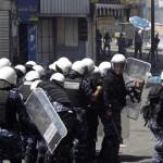 Palestijnse politie tussen Palestijnen en Israëlisch leger in Hebron